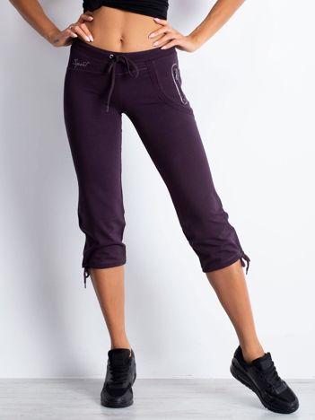 Ciemnofioletowe spodnie dresowe capri z boczną kieszonką