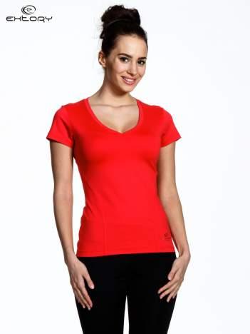Koralowy modelujący damski t-shirt sportowy