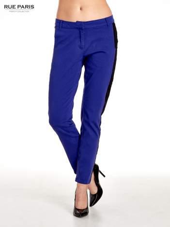 Spodnie cygaretki z czarnym lampasem wzdłuż nogawki