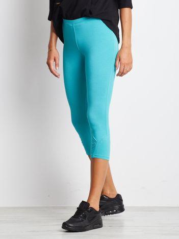 Zielone legginsy sportowe z dżetami i marszczoną nogawką za kolano