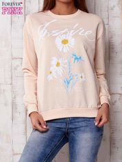 Brzoskwiniowa bluza z nadrukiem kwiatowym i napisem