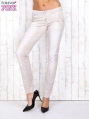 Jasnobeżowe mieniące się spodnie skinny z brokatem i haftami