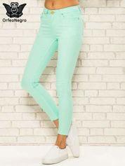 Miętowe spodnie rurki skinny z kieszeniami