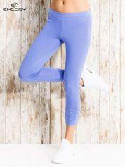 Niebieskie legginsy sportowe z aplikacją z dżetów na nogawkach