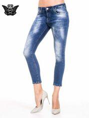 Niebieskie spodnie skinny jeans z cieniowaniem i przetarciami z przodu