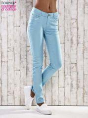 Turkusowe spodnie skinny jeans z koronką
