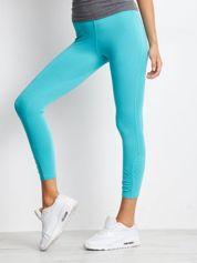 Zielone legginsy sportowe z aplikacją z dżetów na nogawkach