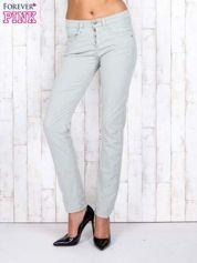 Zielone materiałowe spodnie regular na guziki