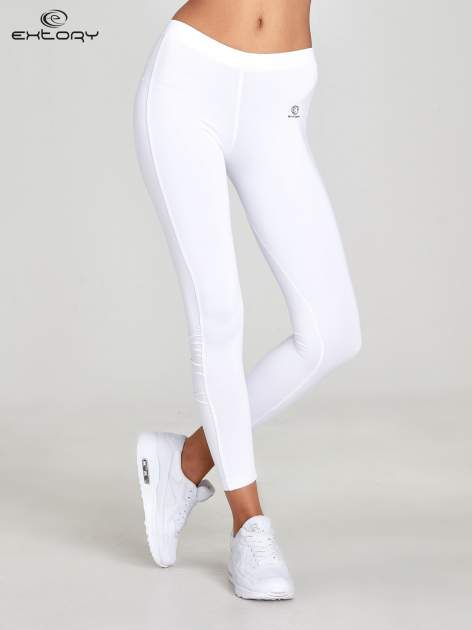 Białe legginsy sportowe termalne z drapowaniem