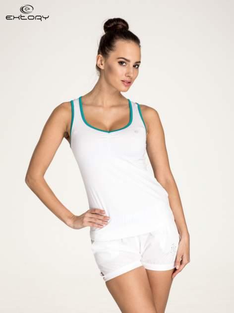 Biały top sportowy V-neck z turkusową lamówką