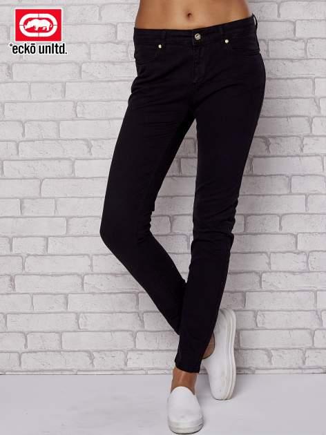 Czarne dopasowane spodnie rurki