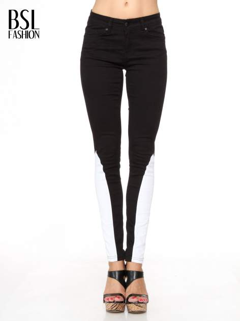 Czarne spodnie jeansowe two tone z białymi modułami na dole