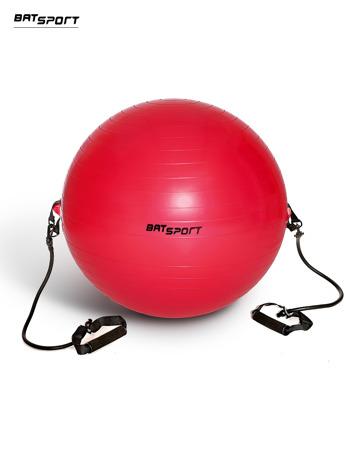 Czerwona średnia piłka fitness z ekspanderami