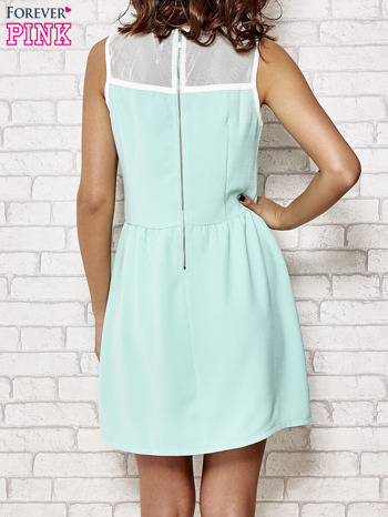 Miętowa sukienka z siateczkową górą