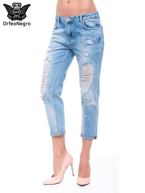 Niebieskie spodnie girlfriend jeans 7/8 z przetarciami
