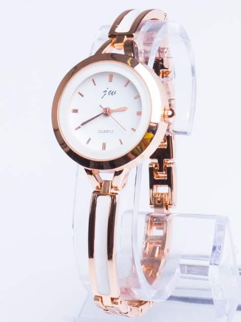 Złoty elegancki i delikatny zegarek damski