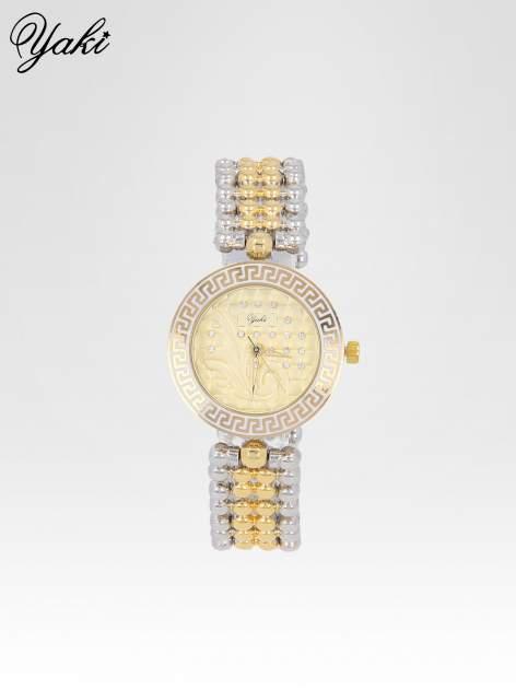 Złoty zegarek na bransolecie z grawerem wokół złotej tarczy