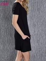 Czarna trapezowa sukienka z kieszeniami
