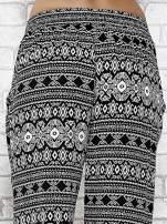 Czarne zwiewne spodnie alladynki we wzór aztecki