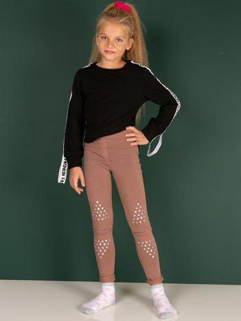Bawełniane beżowe legginsy dziewczęce z wycięciami na kolanach