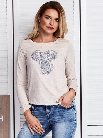 Beżowa bluzka z naszywką słonia