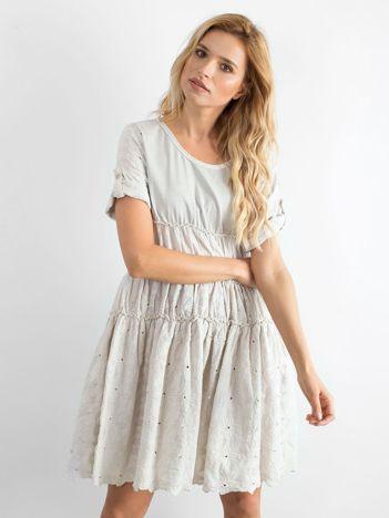 Beżowa rozkloszowana sukienka z haftem