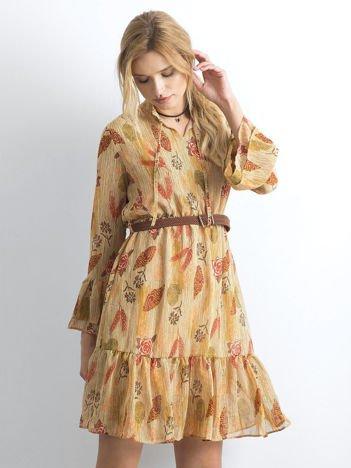 Beżowa sukienka we wzory z falbaną