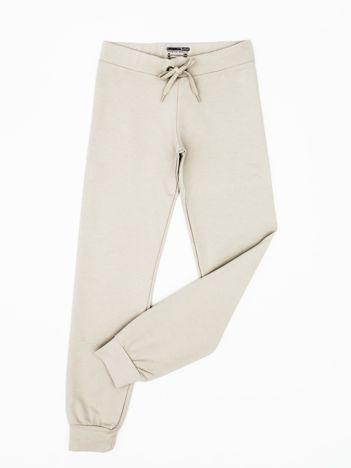 Beżowe dresowe spodnie dziecięce z troczkami