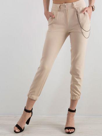 Beżowe spodnie ze ściągaczem