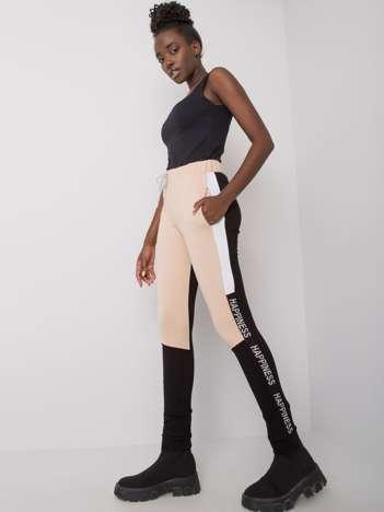 Beżowo-czarne spodnie dresowe z lampasami Happy