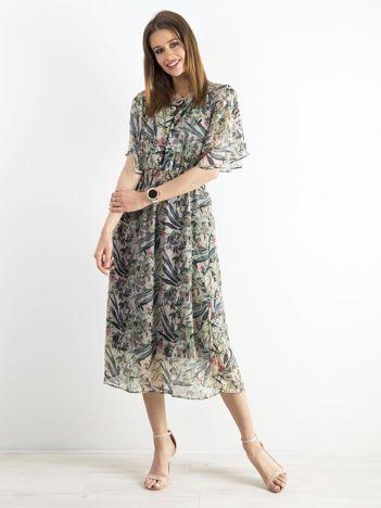 Beżowo-zielona sukienka we wzory