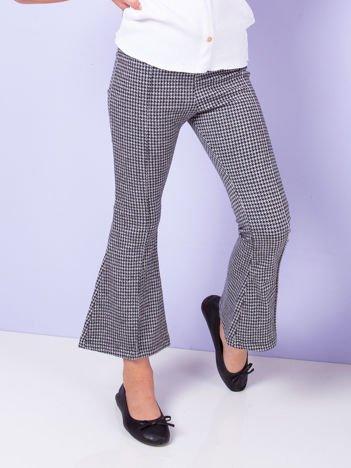 Biało-czarne rozszerzane spodnie dla dziewczynki w pepitkę