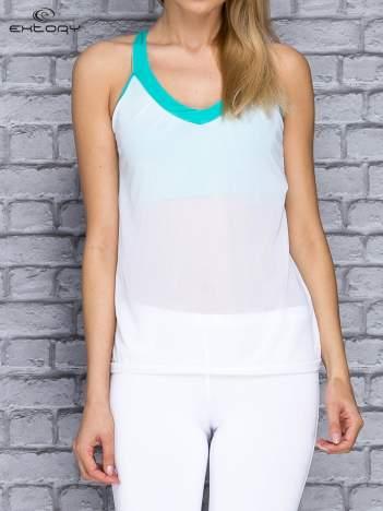 Biały siateczkowy top sportowy z zielonym stanikiem