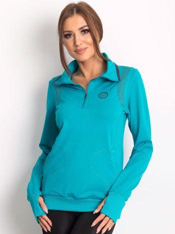 Bluza damska ze stójką i kieszeniami turkusowa