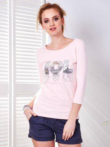 Bluzka jasnoróżowa z cekinowym napisem