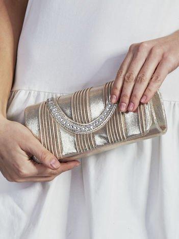 Błyszcząca kopertówka z biżuteryjnym paskiem złota