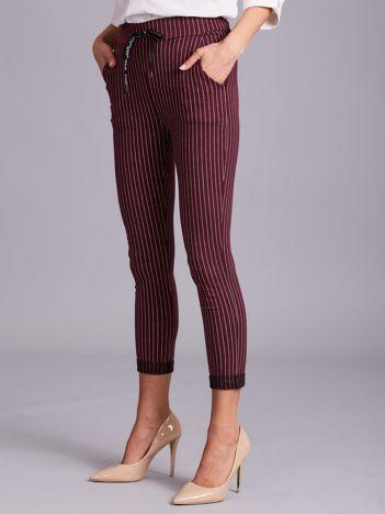 Bordowe damskie spodnie w paski