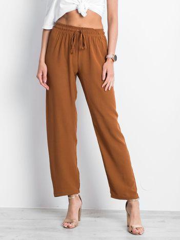 Brązowe spodnie Inability