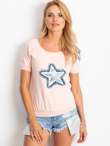 Brzoskwiniowa bluzka z gwiazdą