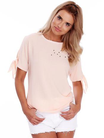Brzoskwiniowa bluzka z perełkami