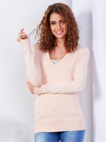Brzoskwiniowy sweter V-neck