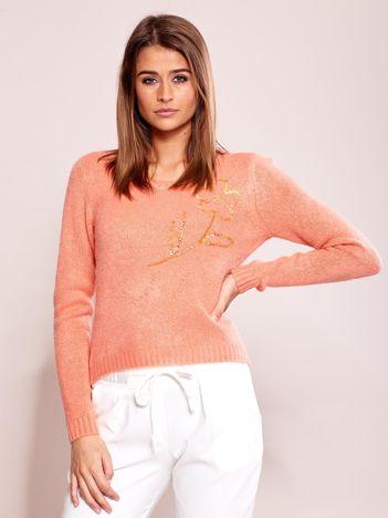 Brzoskwiniowy sweter damski z cekinami