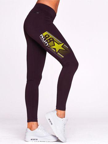 Ciemnofioletowe legginsy gimnastyczne z gwiazdą
