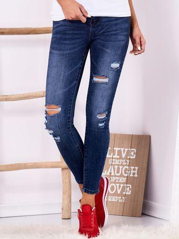 Ciemnoniebieskie jeansowe rurki z suwakami i kokardkami