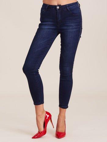 Ciemnoniebieskie jeansy z lampasami