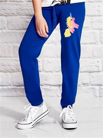 Ciemnoniebieskie spodnie dresowe dla dziewczynki z jednorożcem