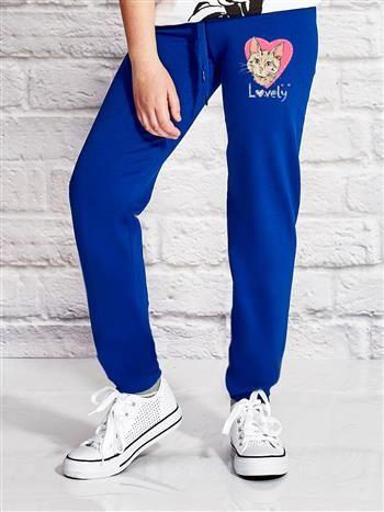 Ciemnoniebieskie spodnie dresowe dla dziewczynki z nadrukiem kota