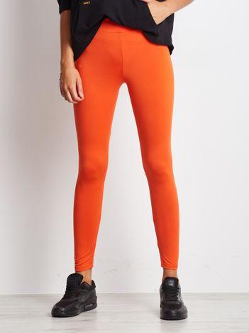 Ciemnopomarańczowe długie cienkie legginsy do biegania