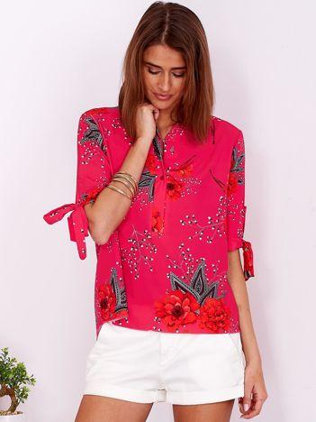 Ciemnoróżowa bluzka w kwiaty z guzikami i wiązaniami