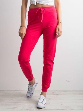 Ciemnoróżowe spodnie dresowe z troczkami